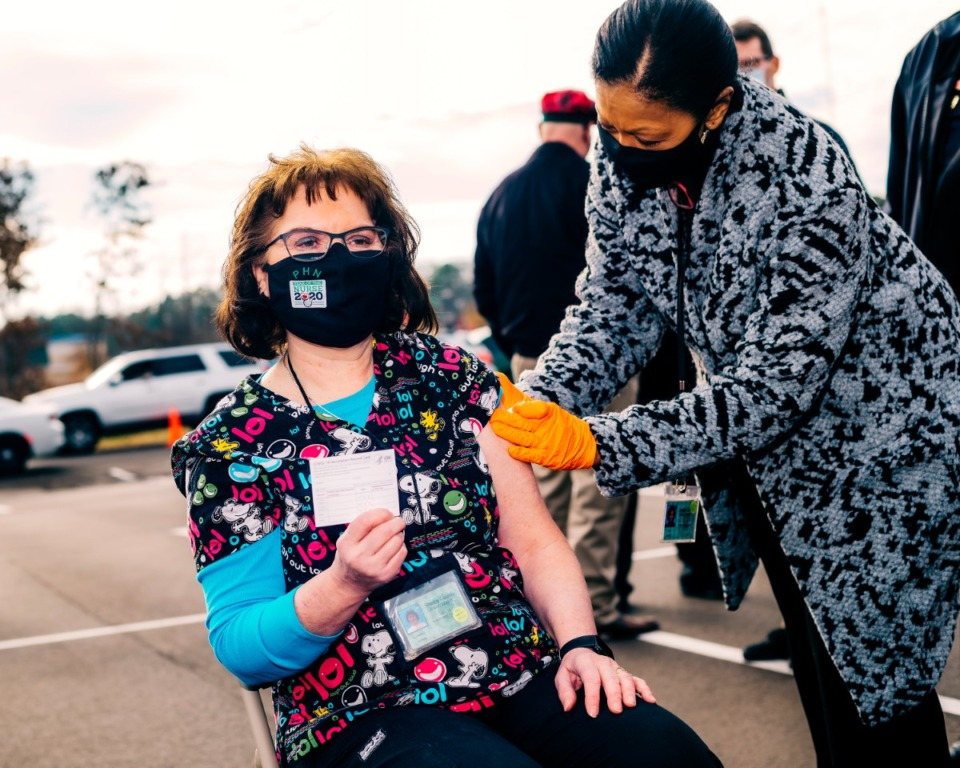 <strong>Janice Stahl, a registered nurse for over 35 years, was the first in a long line of health care and essential workers to receive the cornavirus vaccine on Monday, December 28, 2020.</strong> (Houston Cofield/Special to The Daily Memphian)