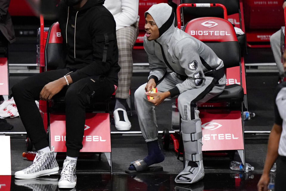 <strong>Memphis Grizzlies guard Ja Morant, right, wears a boot on his left foot after suffering an injury during the team's NBA basketball game against the Brooklyn Nets, Monday, Dec. 28, 2020, in New York.</strong> (AP Photo/Kathy Willens)