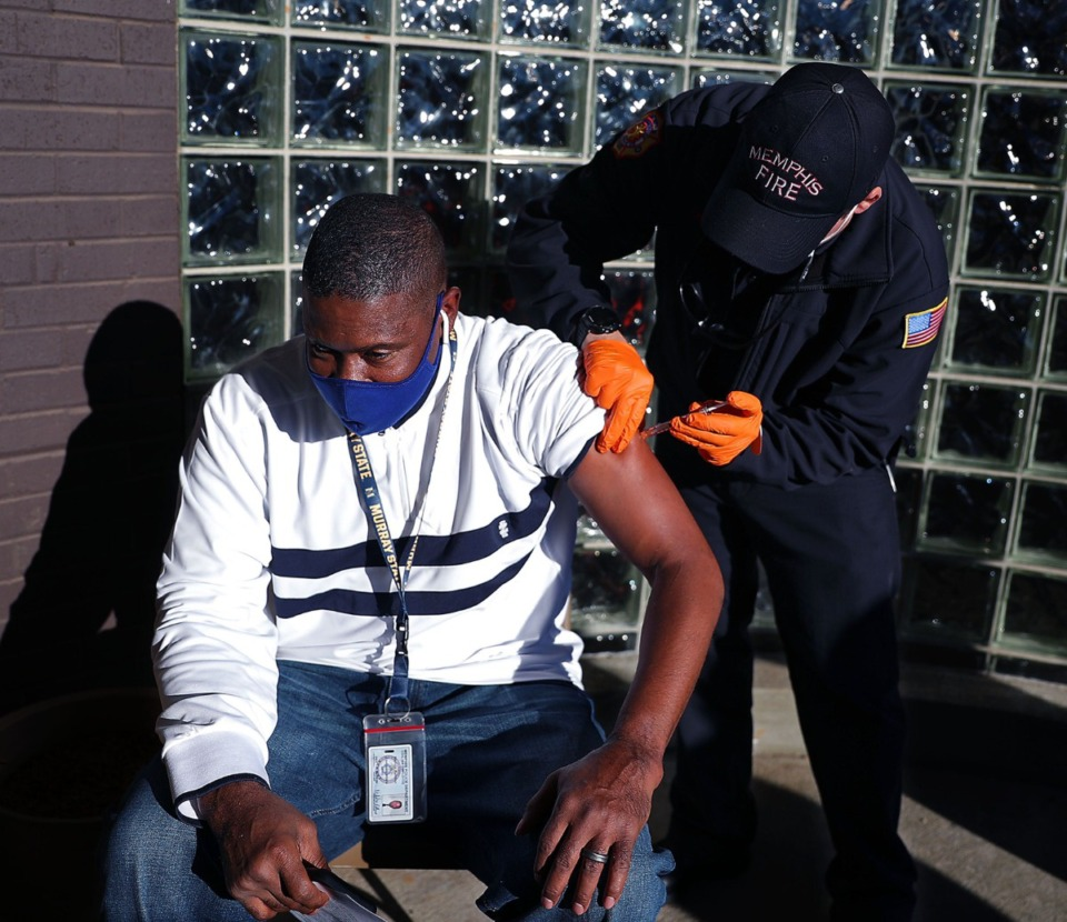<strong>First responder Marvin Render receives a COVID-19 vaccine from Abbott Moses at the Shelby County Health Department office Jan. 3, 2021</strong>. (Patrick Lantrip/Daily Memphian)