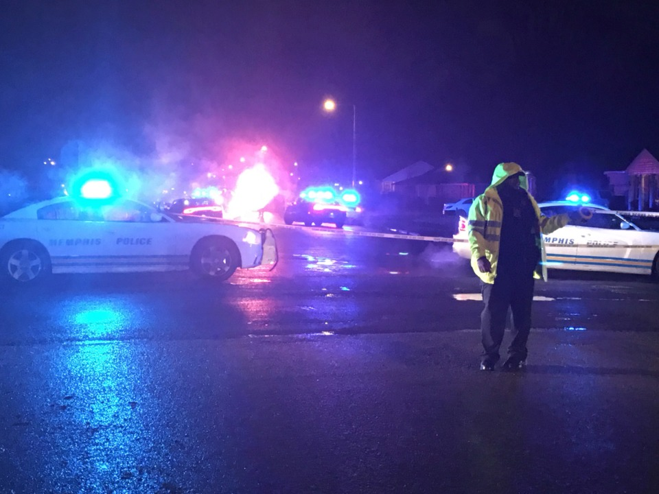 <strong>Memphis Police direct traffic around a fatal officer-involved shooting in Whitehaven Wednesday night.</strong> (Yolanda Jones/Daily Memphian)