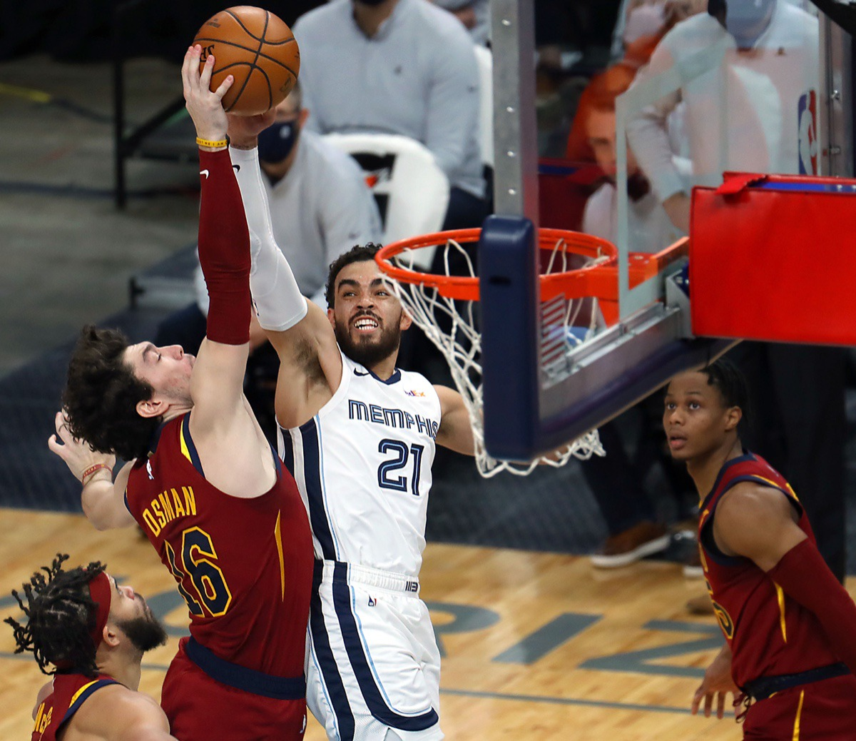 <strong>The Grizzlies&rsquo; Tyus Jones (21) tries to shoot over Cleveland&rsquo;s Cedi Osman (16) on Jan. 7, 2021, at FedExForum.</strong> (Patrick Lantrip/Daily Memphain)