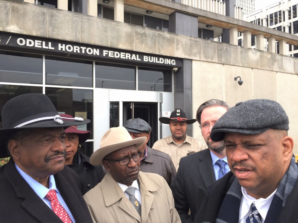 <strong>Appearing outside the federal building Thursday are, from left, Thomas Burrell, president of the Black Farmers and Agriculturalists Association, Bishop David Allen Hall, and their attorneys, Paul Robinson, right, and Gerard Stranch, second from right. </strong>(Wayne Risher/Daily Memphian)