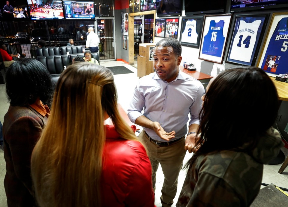 <strong>Corey Strong (middle, in a Feb. 10, 2020 file photo) talks with voters at Ching's Wings.</strong> (Mark Weber/Daily Memphian)