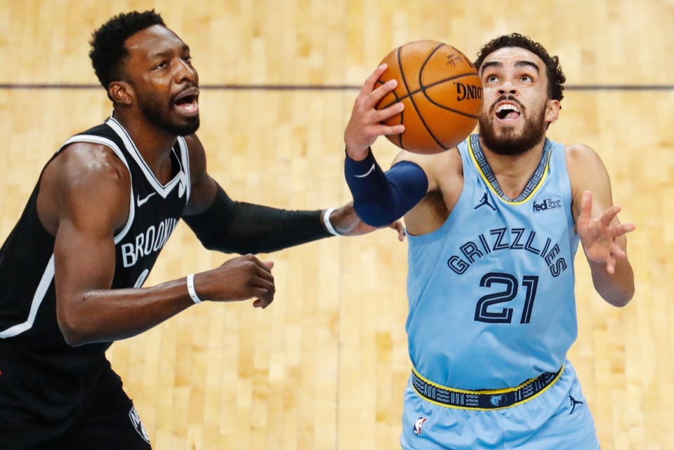<strong>Grizzlies guard Tyus Jones (right) makes a layup in front of Brooklyn&rsquo;s Jeff Green (left) on Friday, Jan. 8, 2021.</strong> (Mark Weber/The Daily Memphian)