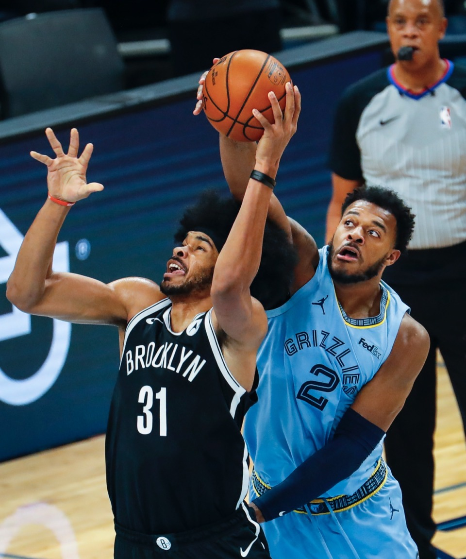 <strong>Grizzlies forward Xavier Tillman Sr. (right) blocks the shot of Brooklyn&nbsp;center Jarrett Allen (left) on Friday, Jan. 8, 2021.</strong> (Mark Weber/The Daily Memphian)