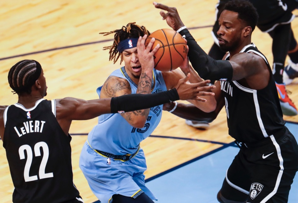 <strong>Grizzlies forward Brandon Clarke (middle) drives the lane against Brooklyn&rsquo;s Caris LeVert (left) and Jeff Green (right) on Friday, Jan. 8, 2021.</strong> (Mark Weber/The Daily Memphian)