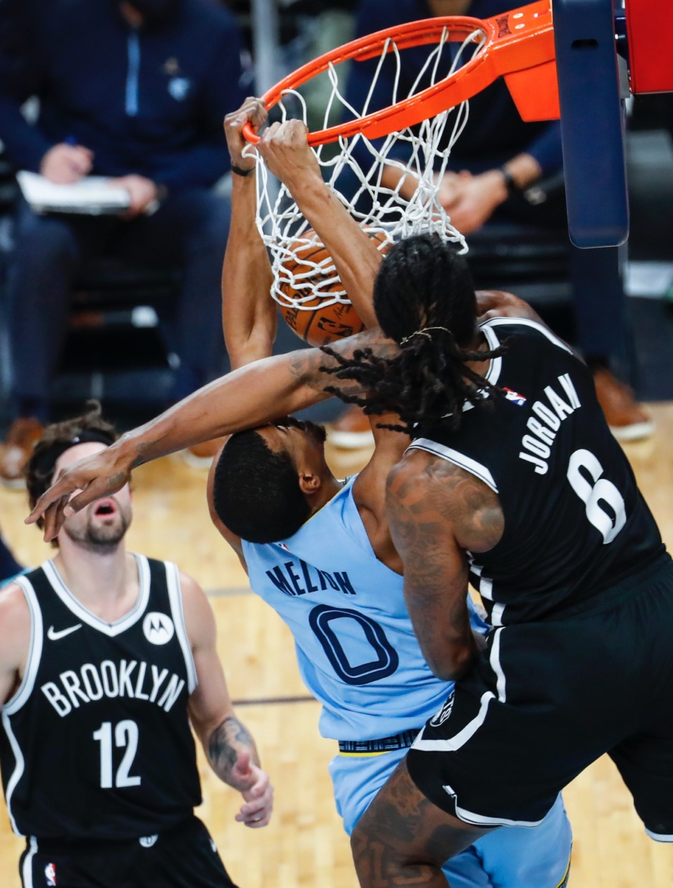 <strong>Grizzlies guard De'Anthony Melton (left) dunks over Brooklyn&rsquo;s Jeff Green (right) on Friday, Jan. 8, 2021.</strong> (Mark Weber/The Daily Memphian)