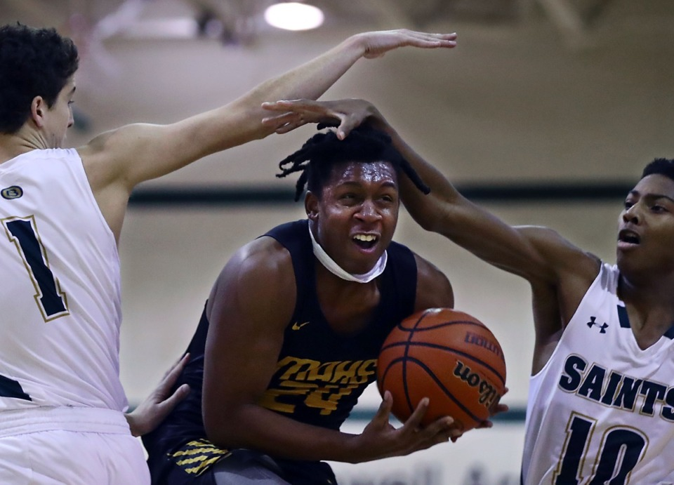 <strong>Memphis Academy of Health Sciences guard Cameron Miller (24) charges to the basket during the Jan. 8, 2020, game against Briarcrest Christian School.</strong> (Patrick Lantrip/Daily Memphian)