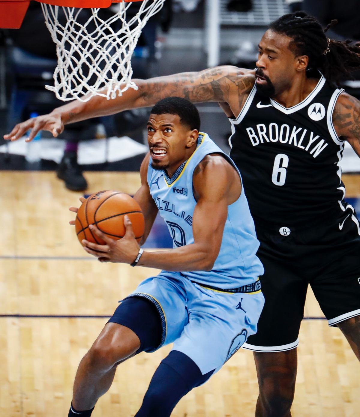 <strong>Memphis Grizzlies guard De'Anthony Melton (left) drives for a layup in front of Brooklyn&rsquo;s DeAndre Jordan (right) on Friday, Jan. 8, 2021.</strong> (Mark Weber/The Daily Memphian)