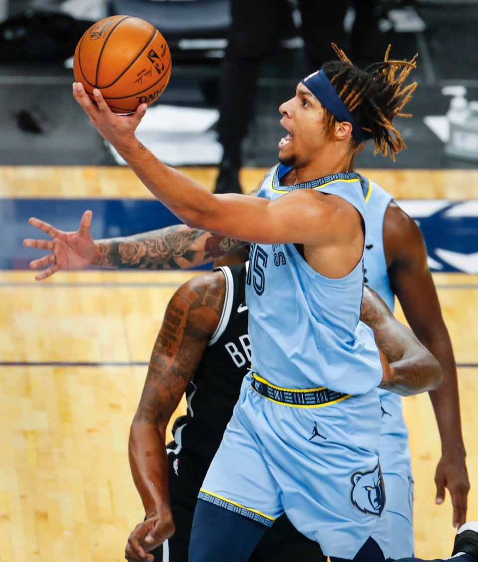 <strong>Grizzlies forward Brandon Clarke drives for a layup against the Nets on Jan. 8, 2021.</strong> (Mark Weber/The Daily Memphian)