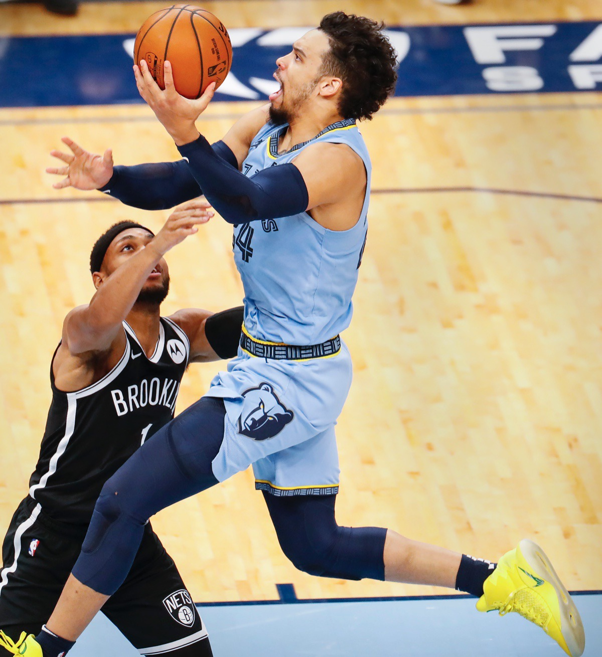 <strong>Grizzlies guard Dillion Brooks (right) lays in two against Brooklyn&rsquo;s Bruce Brown (left) on Friday, Jan. 8, 2021.</strong> (Mark Weber/The Daily Memphian)