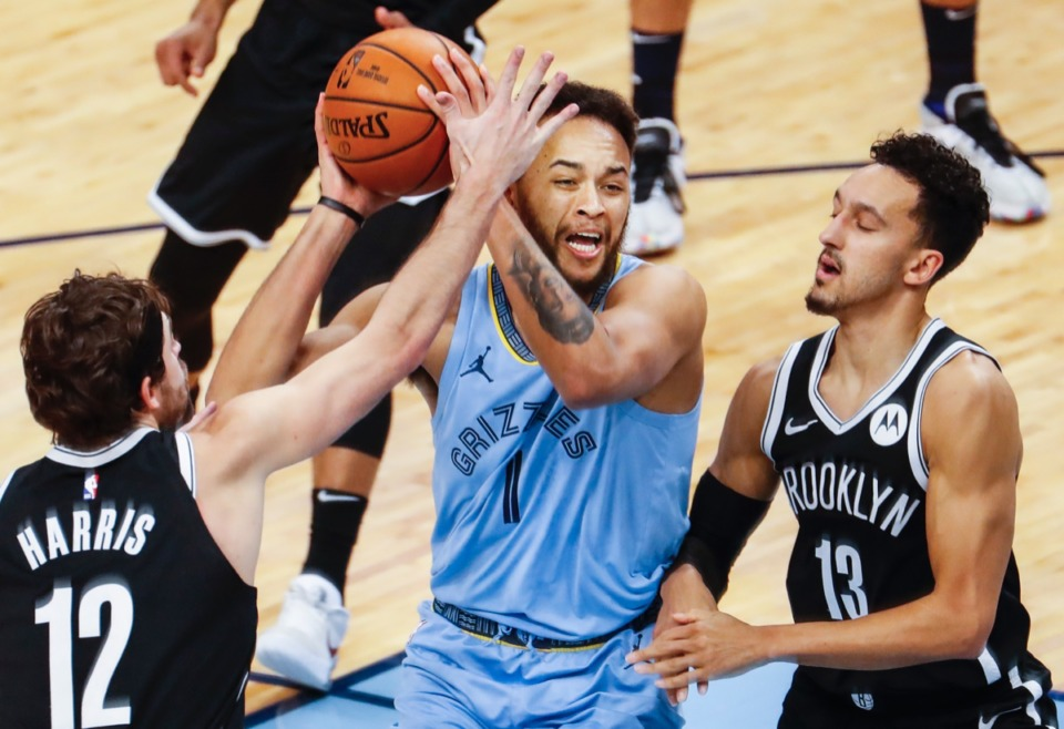 <strong>Grizzlies forward Kyle Anderson (middle) drives the lane against Brooklyn on Jan. 8, 2021.</strong> (Mark Weber/The Daily Memphian)