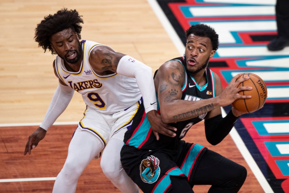 <strong>Memphis Grizzlies forward Xavier Tillman Sr. (2) keeps the ball from Los Angeles Lakers guard Wesley Matthews (9) during the first half of an NBA basketball game Sunday, Jan. 3, 2021, at FedExForum.</strong> (Wade Payne/AP)
