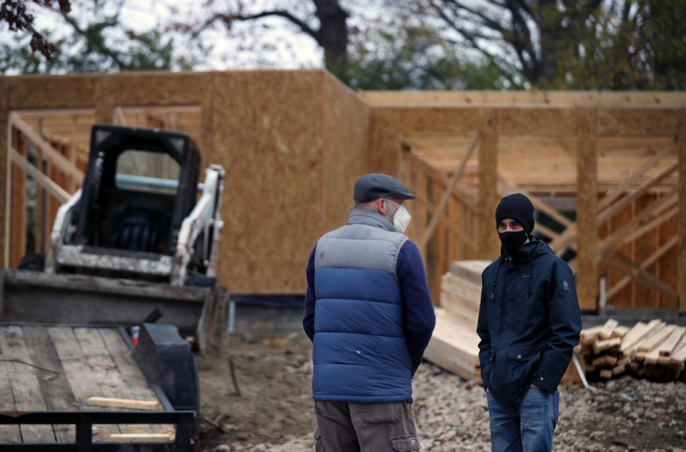 <strong>Philip Walkley (right), executive director of SOS (Service Over Self), talks with Binghampton resident Billy Vaughan about a home that's under construction in the Binghampton neighborhood Jan. 9, 2021.</strong> (Patrick Lantrip/Daily Memphian)