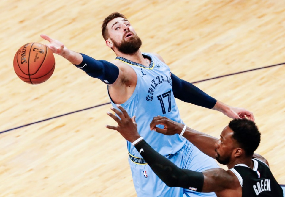 <strong>Memphis Grizzlies center Jonas Valanciunas (top) can not hang onto a rebound while guarded by Brooklyn Nets defender Jeff Green (bottom) during action on Friday, January 8, 2021.</strong> (Mark Weber/The Daily Memphian)