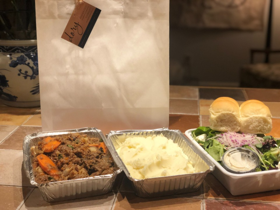<strong>Beef Bourguignon, potatoes puree, a fresh salad and excellent yeast rolls make a nice takeout dinner for two with plenty of leftovers.</strong> (Jennifer Biggs/Daily Memphian)