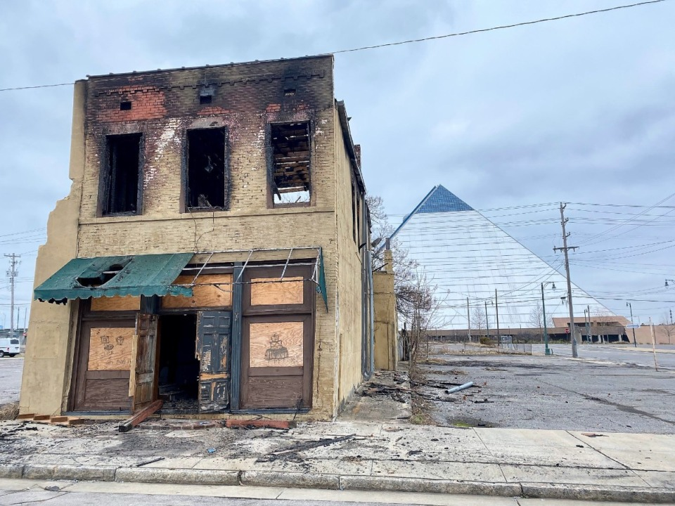 <strong>Fire early Saturday morning, Jan. 9, engulfed the 120-year-old building on N. Main near Overton. The building already is flanked by surface parking lots, which threaten the standing of the Pinch-North Main Historic District.</strong> (Tom Bailey/Daily Memphian)