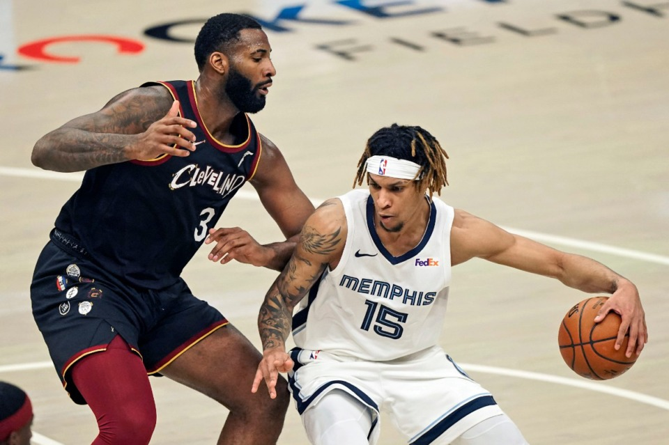 <strong>The Grizzlies' Brandon Clarke (15) drives past Cleveland&rsquo;s Andre Drummond (3) on Monday, Jan. 11, 2021, in Cleveland.</strong> (Tony Dejak/AP)