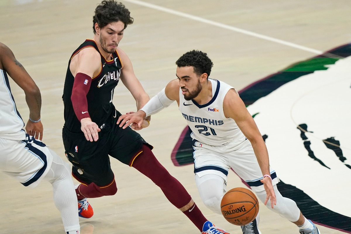 <strong>The Grizzlies' Tyus Jones (21) drives past Cleveland&rsquo;s Cedi Osman (16) on Jan. 11, 2021, in Cleveland.</strong> (Tony Dejak/AP)