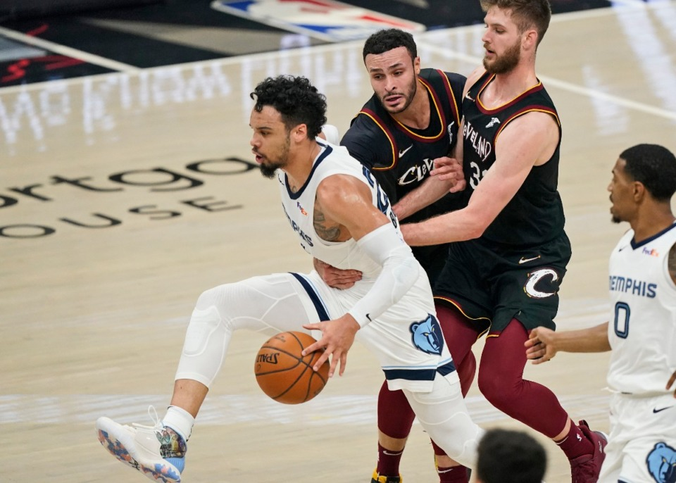 <strong>Memphis Grizzlies' Dillon Brooks, left, is fouled by Cleveland&rsquo;s Larry Nance Jr., second from left, on Jan. 11, 2021, in Cleveland. Cavaliers' Dean Wade, second from right, and Grizzlies' De'Anthony Melton, right, watch.</strong> (Tony Dejak/AP)