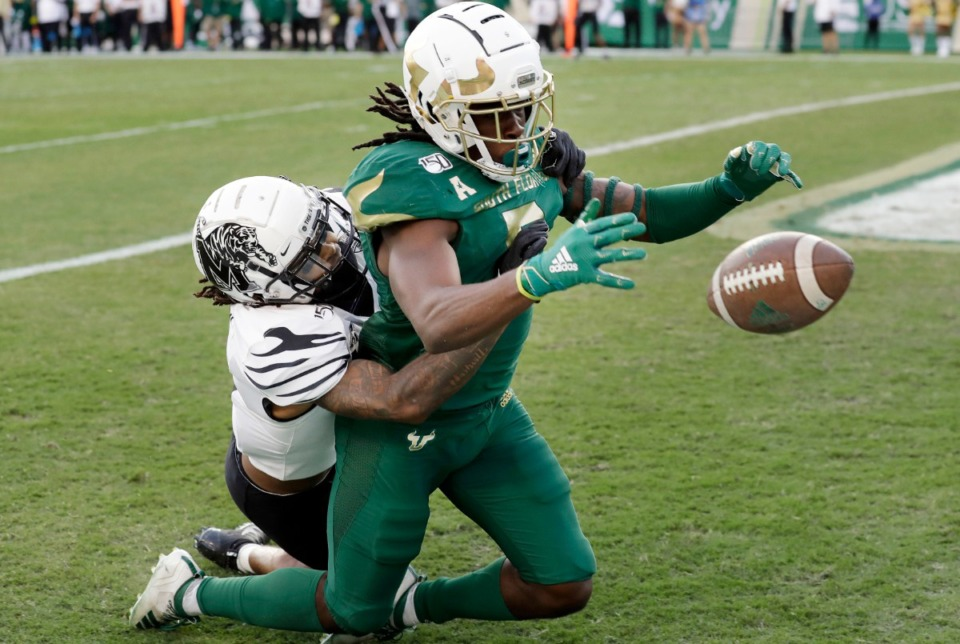 <strong>South Florida wide receiver Randall St. Felix (5) can't make the catch as he is taken down by Memphis defensive back T.J. Carter during the first half of an NCAA college football game Saturday, Nov. 23, 2019, in Tampa, Florida</strong>. (AP File Photo/Chris O'Meara)