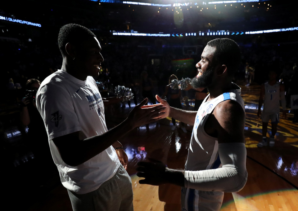 <strong>University of Memphis Tigers forward Raynere Thornton (4) shakes hands with forward Lance Thomas (15) prior to the start of the game against the Wichita State Shockers on Thursday, Jan. 3, 2019.</strong> (Houston Cofield/Daily Memphian)