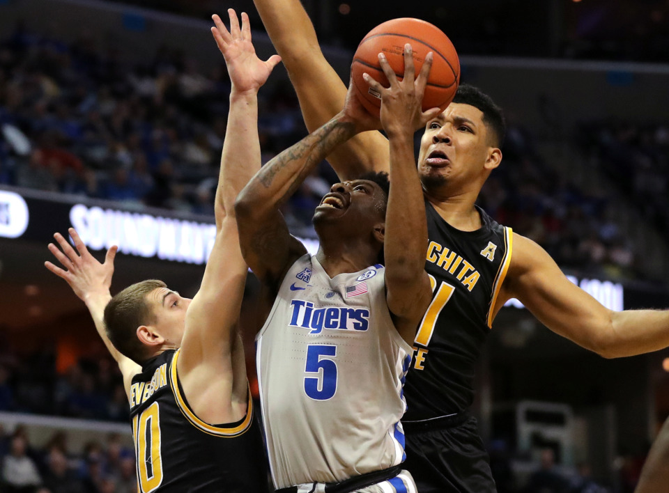 <strong>University of Memphis Tigers guard Kareem Brewton Jr. (5) drives to the basket during a game against the Wichita State Shockers on Thursday, Jan. 3, 2019.</strong> (Houston Cofield/Daily Memphian)