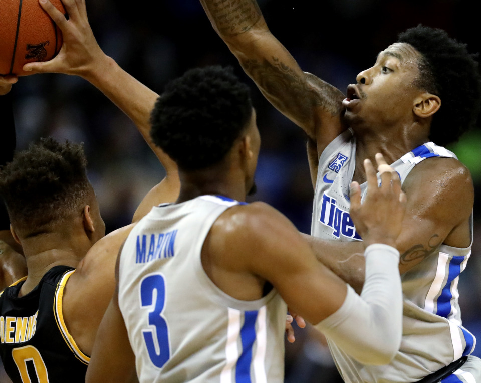 <strong>University of Memphis Tigers guard Kareem Brewton Jr. (5) and guard Jeremiah Martin (3) defend Wichita State Schockers' guard Dexter Dennis (0) during a game against the Wichita State Shockers on Thursday, Jan. 3, 2019.</strong> (Houston Cofield/Daily Memphian)