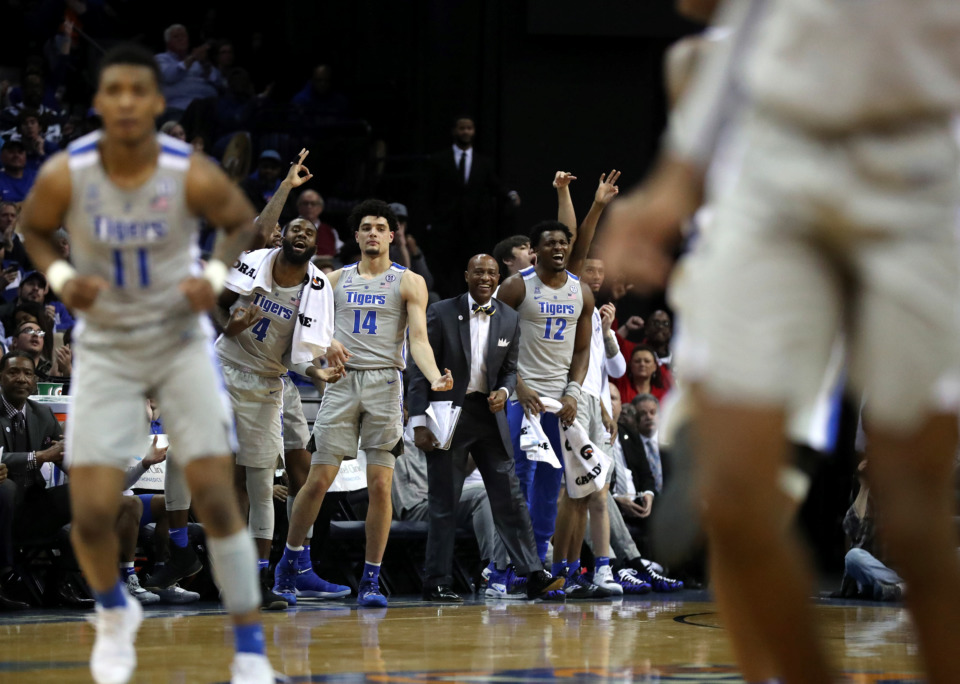 <strong>The University of Memphis Tigers bench jumps up to celebrate after a Tiger basket during a game against the Wichita State Shockers on Thursday, Jan. 3, 2019.</strong> (Houston Cofield/Daily Memphian)