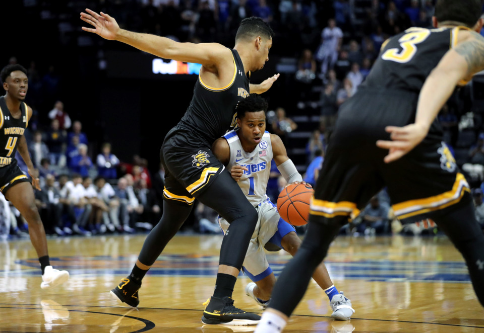 <strong>University of Memphis Tigers guard Tyler Harris (1) weaves through a Wichita State Shockers defense during a game against the Shockers on Thursday, Jan. 3, 2019.</strong> (Houston Cofield/Daily Memphian)