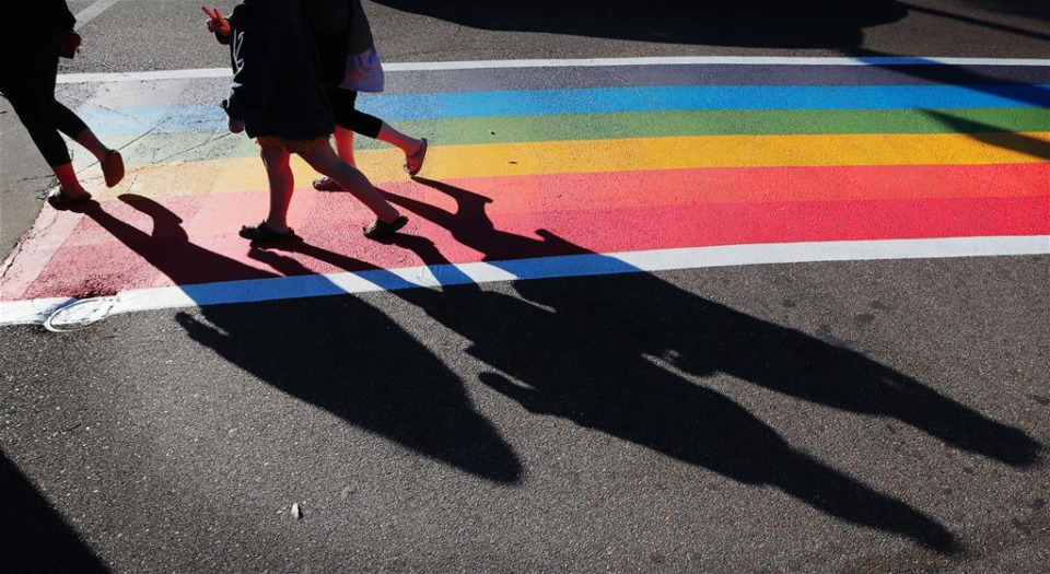 <strong>Pedestrians make use of the state&rsquo;s first rainbow colored crosswalk at the corner of Cooper and Young. Plans have been approved for another rainbow crosswalk as well as a crosswalk with the words Black Lives Matter at the intersection of Cooper and Monroe.</strong>&nbsp;(Jim Weber/Daily Memphian)