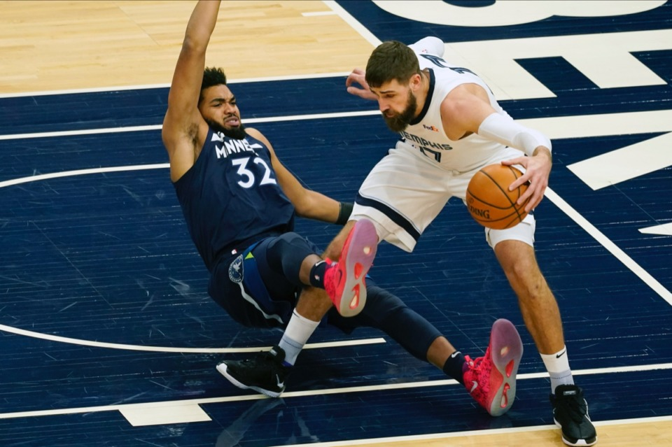 <strong>Minnesota&rsquo;s Karl-Anthony Towns, left, gets tangled up with Memphis Grizzlies' Jonas Valanciunas on Wednesday, Jan. 13, 2021, in Minneapolis.</strong> (Jim Mone/AP)