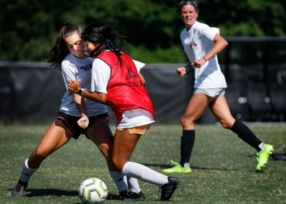 <strong>Houston High School girls soccer teammates Kate O&rsquo;Connor (left) and Lauren Fang (right) battle during practice Wednesday, August 5, 2020</strong>. (Mark Weber/Daily Memphian file)
