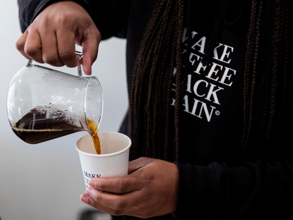 <strong>J.C. Cofield pours a cup of coffee Thursday, Jan. 14, 2021 at the recently opened Not a Coffee Shop, at 761 National St. in the Heights neighborhood.</strong> (Brad Vest/Special to Daily Memphian)