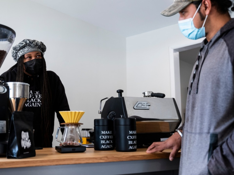 <strong>J.C. Cofield (left) talks with Carlos Gonzales, while brewing a beverage at Not a Coffee Shop, where only black coffee is served. The drinks include no sweetener, milk or flavoring. </strong>(Brad Vest/Special to Daily Memphian)