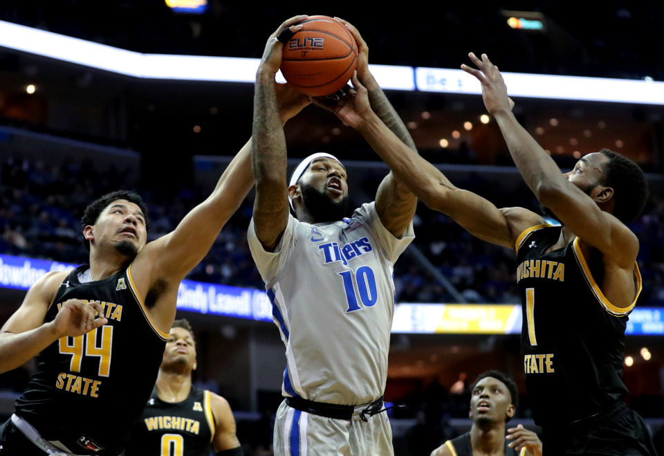 <strong>University of Memphis Tigers forward Mike Parks Jr. (10) battles for possession during a game against the Wichita State Shockers on Thursday, Jan. 3, 2019. The Tigers beat the Shockers 85-74.</strong> (Houston Cofield/Daily Memphian)
