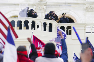 <strong>Supporters loyal to President Donald Trump clash with authorities before successfully breaching the Capitol building during a riot on the grounds, Wednesday, Jan. 6, 2021.</strong> (AP Photo/John Minchillo)