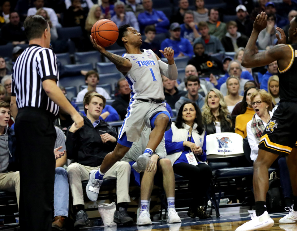 <strong>University of Memphis Tigers guard Tyler Harris (1) throws the ball back in bounds during a game against the Wichita State Shockers on Thursday, Jan. 3, 2019. The Tigers beat the Shockers 85-74.</strong> (Houston Cofield/Daily Memphian)