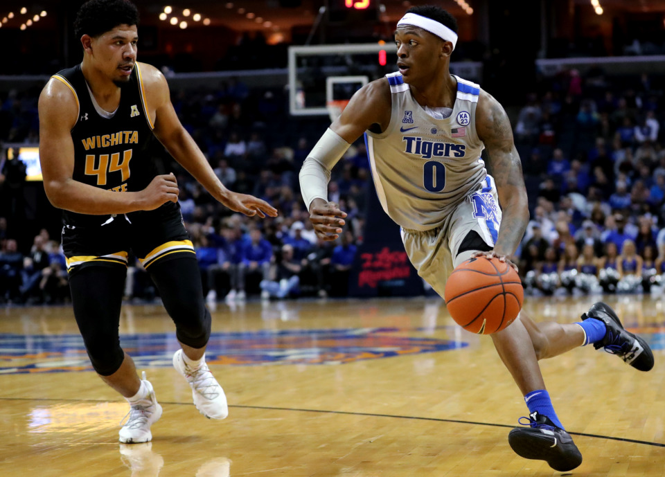 <strong>University of Memphis Tigers forward Kyvon Davenport (0) drives toward the basket against Wichita State forward Isaiah Chandler (44) during a game against the Shockers on Thursday, Jan. 3, 2019. The Tigers beat the Shockers 85-74.</strong> (Houston Cofield/Daily Memphian)