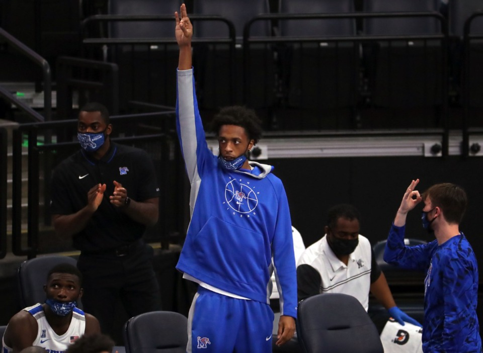 <strong>University of Memphis forward DeAndre Williams holds up three fingers in celebration after a teammate hits an open three during a Dec. 4, 2020, home game against the University of Central Arkansas.</strong> (Patrick Lantrip/Daily Memphian file)