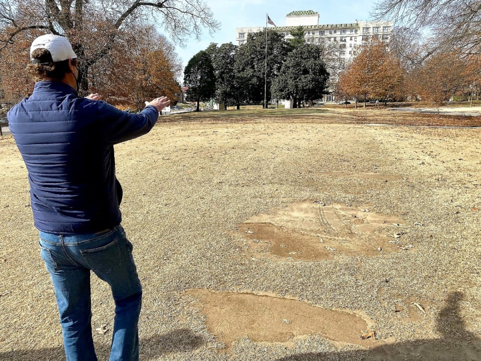 <strong>Golf course designer Rob Collins shows how he will redesign the area around the 8th green during a recent tour of Overton Park golf course.</strong> (Tom Bailey/Daily Memphian file)