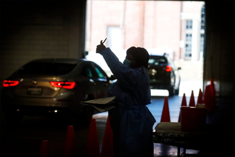 <strong>Shelby Health Department personnel and volunteers administer COVID-19 vaccinations on Tuesday, Jan. 12, 2021 in the Pipkin Building at Tiger Lane.</strong> (Mark Weber/The Daily Memphian)