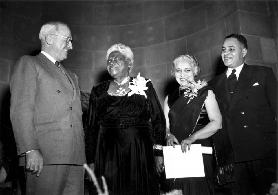 <strong>Mary McLeod Bethur (second from left) is one of the historic individuals featured in &ldquo;Say It Loud.&rdquo; In 1949 President Harry Truman posed with Bethune, Madame Vijaya Lakshmi Pandit (Ambassador of India to the United States), and Dr. Ralph Bunche (UN Director of Trusteeship) when they were presented with citations for outstanding citizenship.</strong> (Harvey Georges/AP file)