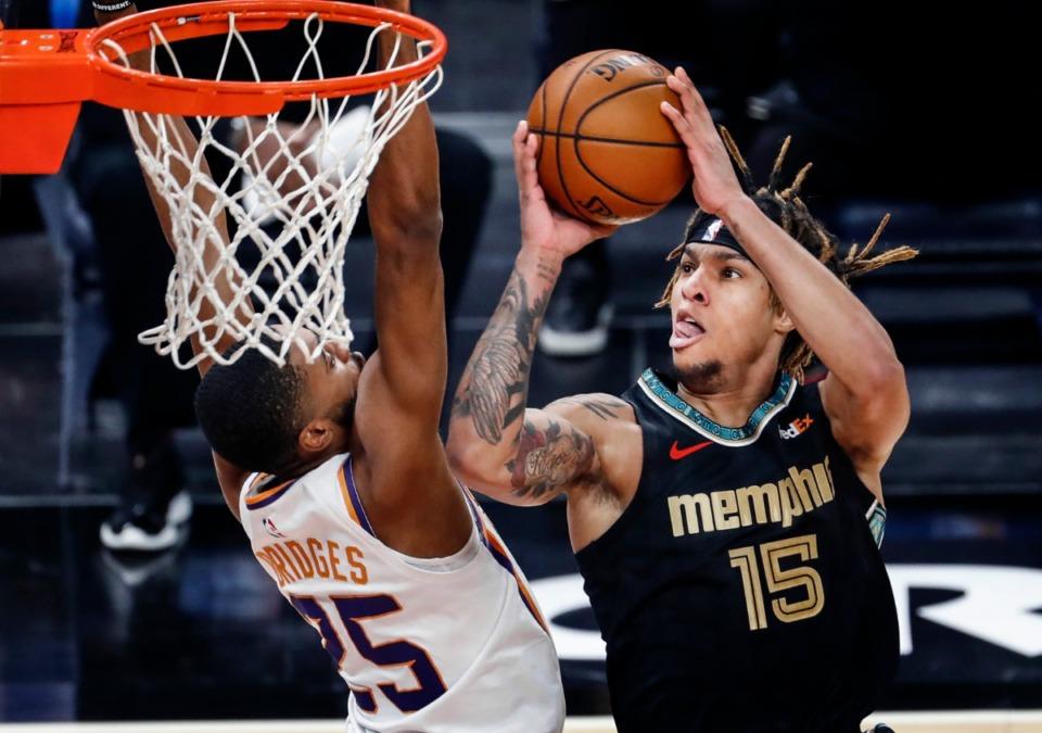 <strong>Memphis Grizzlies forward Brandon Clarke (right) drives to the basket against Phoenix Suns defender Mikal Bridges (left) during action on Monday, Jan. 18, 2021.</strong> (Mark Weber/The Daily Memphian)