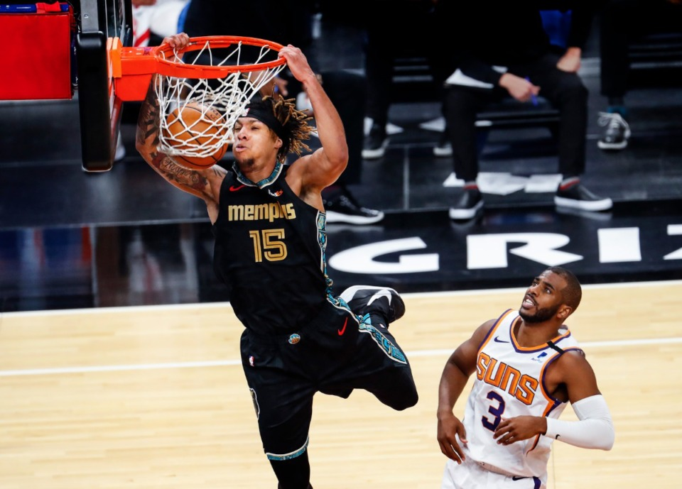 <strong>Memphis Grizzlies forward Brandon Clarke (left) dunks in front of Phoenix Suns defender Chris Paul (right) during action on Monday, Jan. 18, 2021.</strong> (Mark Weber/The Daily Memphian)