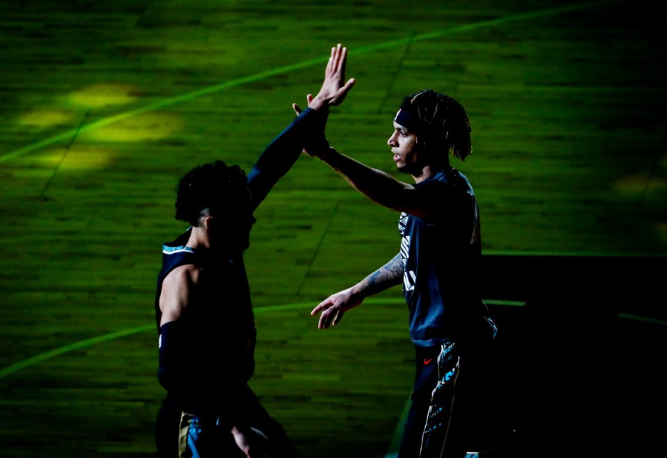 <strong>Memphis Grizzlies forward Brandon Clarke (right) high-fives teammate Dillon Brooks before taking on the Phoenix Suns on Monday, Jan. 18, 2021.</strong> (Mark Weber/The Daily Memphian)