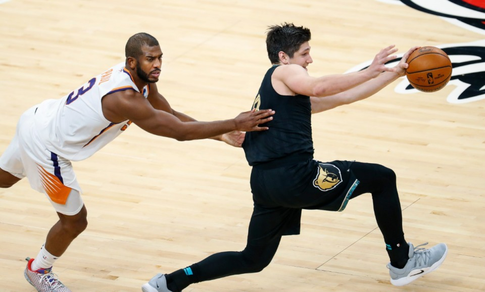 <strong>Memphis Grizzlies guard Grayson Allen (right) is fouled by Phoenix Suns defender Chris Paul (left) during action on Monday, Jan. 18, 2021.</strong> (Mark Weber/The Daily Memphian)