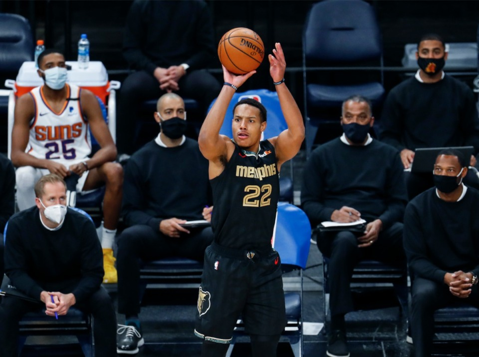 <strong>Memphis Grizzlies guard Desmond Bane (middle) puts up a 3-point shot in front of the Phoenix Suns bench during action on Monday, Jan. 18, 2021.</strong> (Mark Weber/The Daily Memphian)