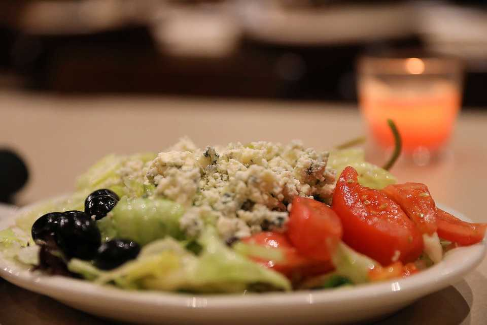 <strong>Pete &amp; Sam's Famous Italian Salad with lettuce, tomato, black olives, olive oil and vinegar.</strong> (Patrick Lantrip/Daily Memphian)