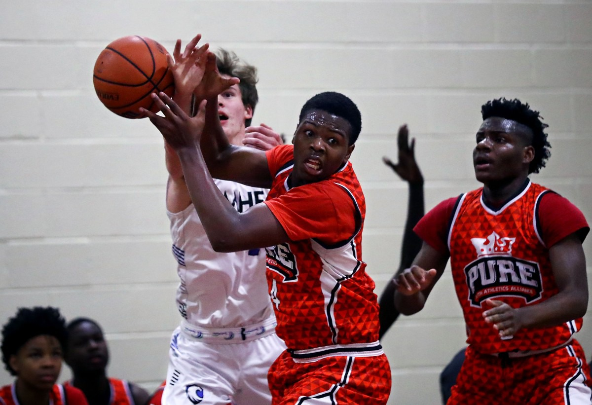 <strong>PURE Youth Athletics Alliance guard Jacob Roberts (4) fights for a loose ball during a Jan. 19, 2020, game against MHEA at East Side Baptist Church.</strong> (Patrick Lantrip/Daily Memphian)